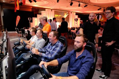 Networked rally driving game for four people at corporate event