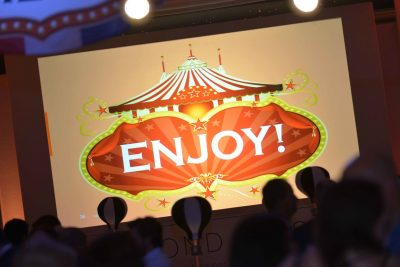 A carnival style welcome screen with the word 'Enjoy' featured