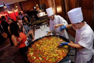 2 chefs serve Paella street food at corporate event